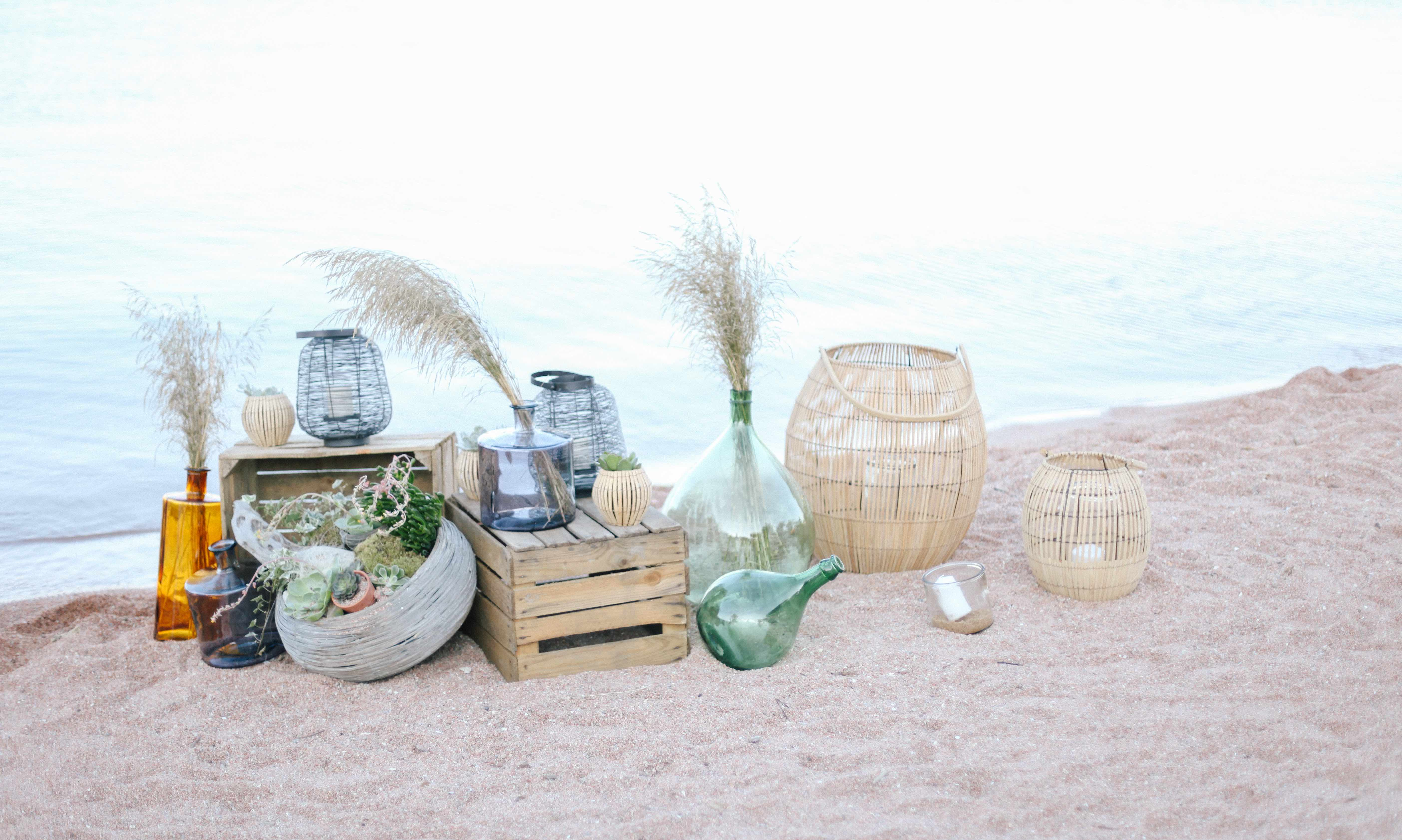 lantern and bottles on the beach